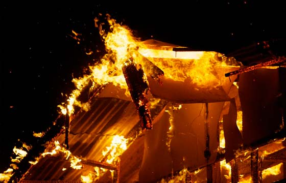 HPG Insurance Works - insurance repairs image of house on fire at night time.