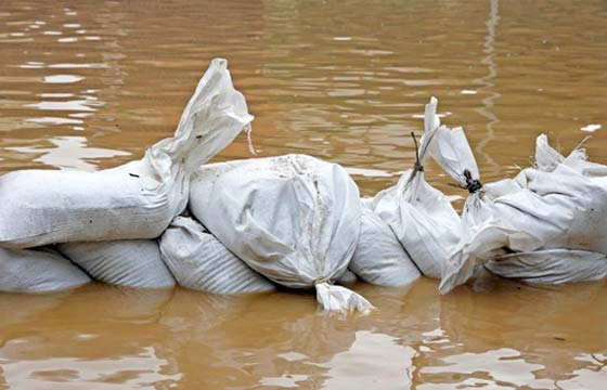 HPG Insurance Works - insurance repairs image of sand bagging flood water.
