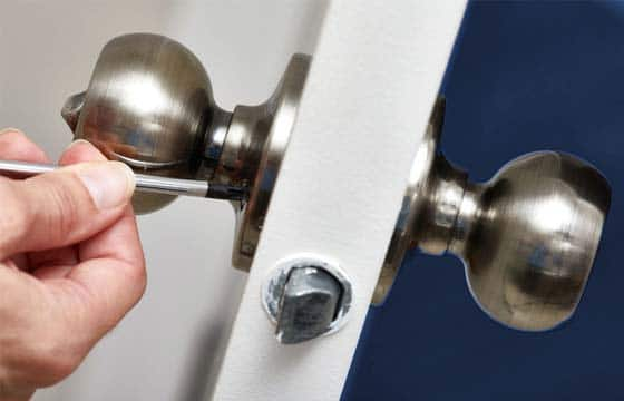 HPG Insurance Works - property maintenance image of a tradesperson replacing a interior door handle.