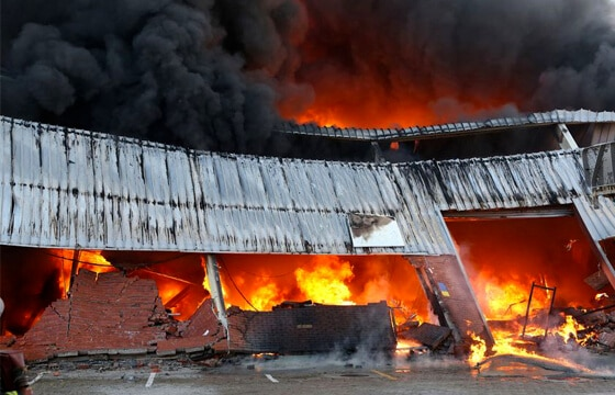 HPG Insurance & Maintenance Work complex claims major loss image of warehouse burning down